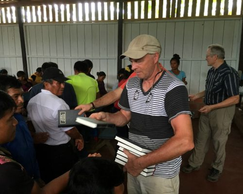 Mike-Handing-Out-Bibles